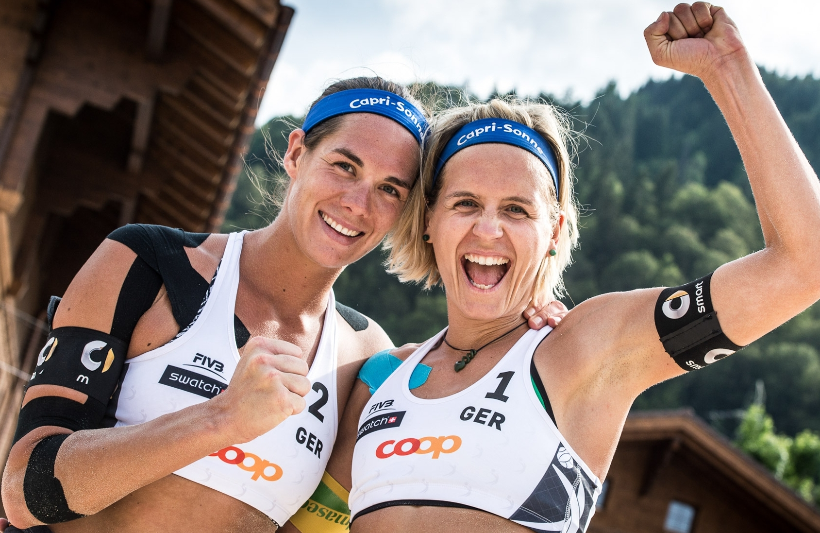 CAPTION: Kira and Laura celebrate in Gstaad. Photocredit: Mihai Stetcu.
