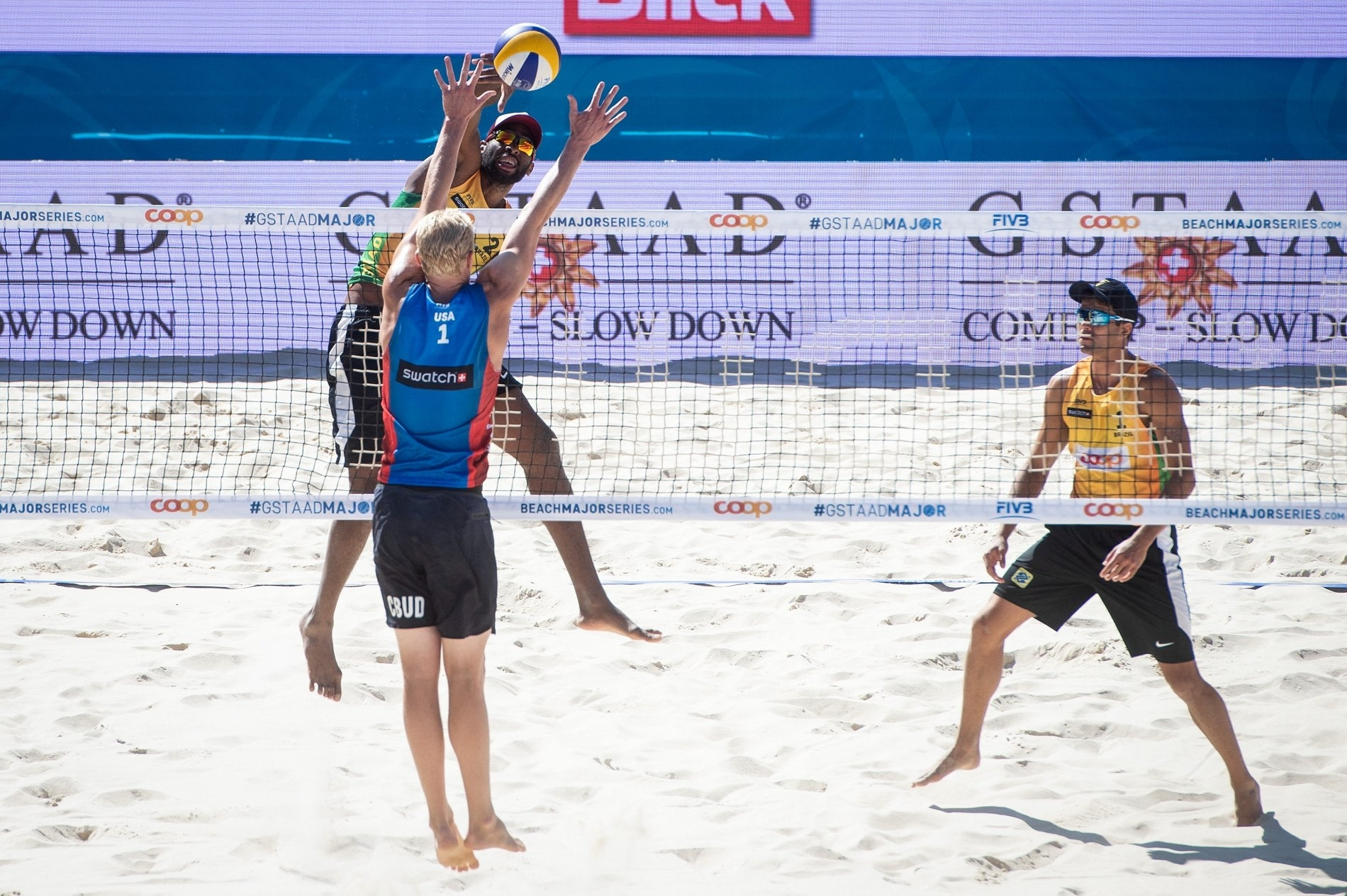 Budinger (in blue) blocks Evandro at the net on the way to a shock straight sets victory