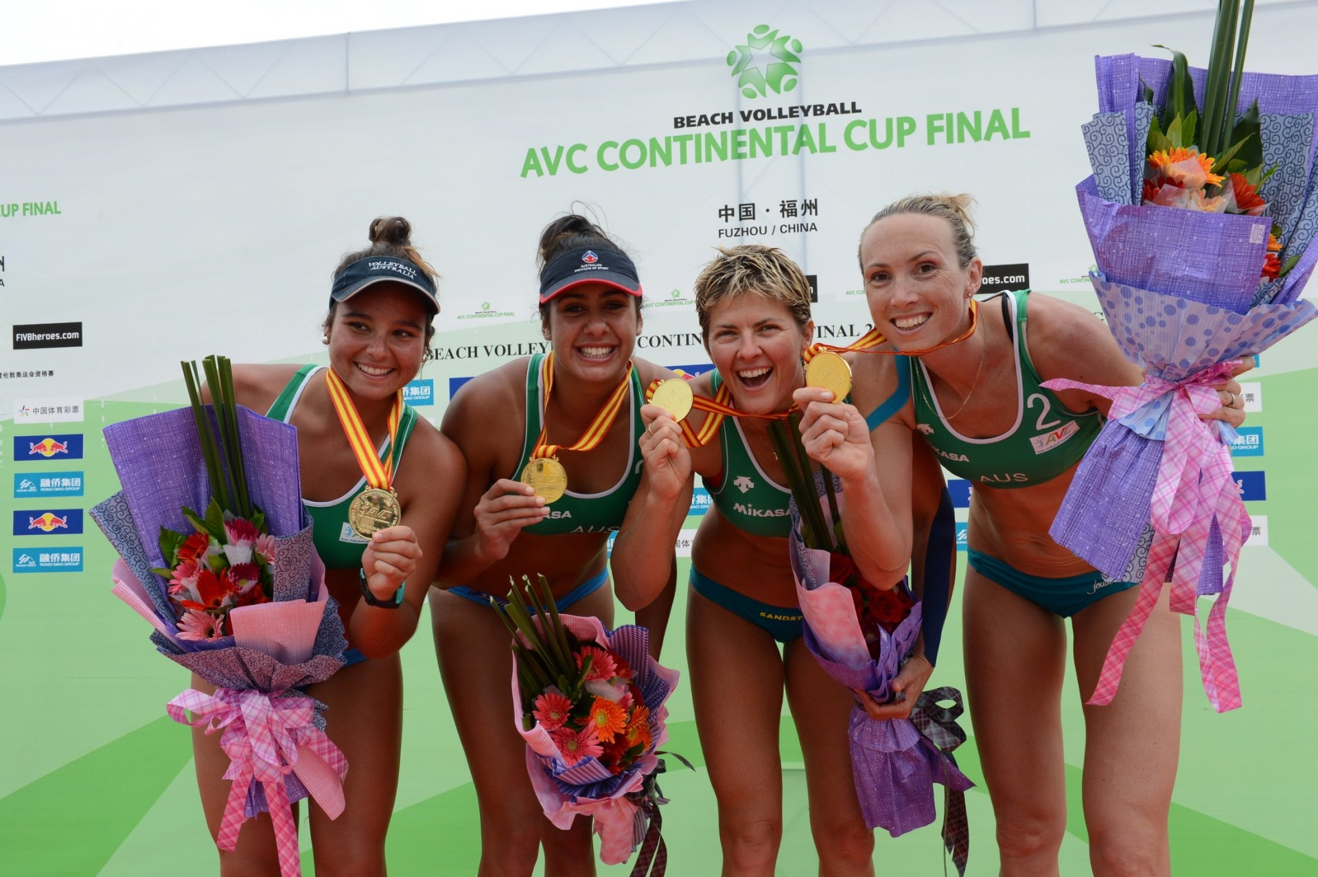 Artacho and Clancy with Australian legend Natalie Cook and her partner Tamsin Hinchley in 2012 (Photocredit: FIVB)
